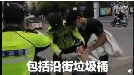 交警最后关头垃圾桶找到准考证怎么回事 事件详情结果如何